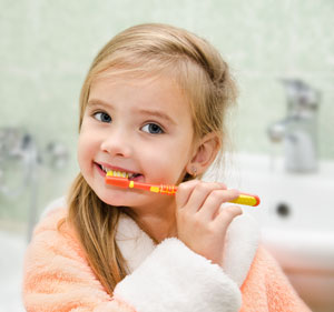 Pediatric Dentist and Orthodontist Dr. Steven Marcello - Brushing Teeth